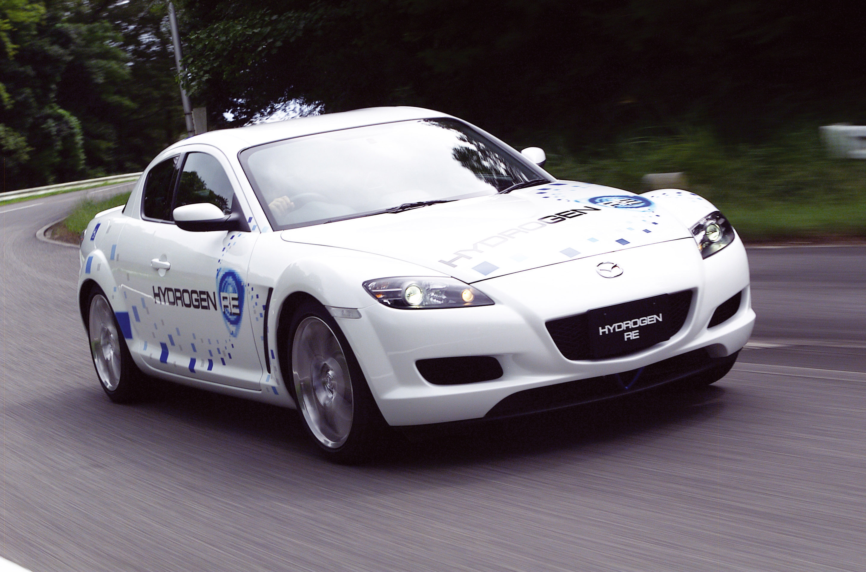 https://www.carsinvasion.com/gallery/2003-mazda-rx-8-hydrogen-concept/2003-mazda-rx-8-hydrogen-concept-04.jpg